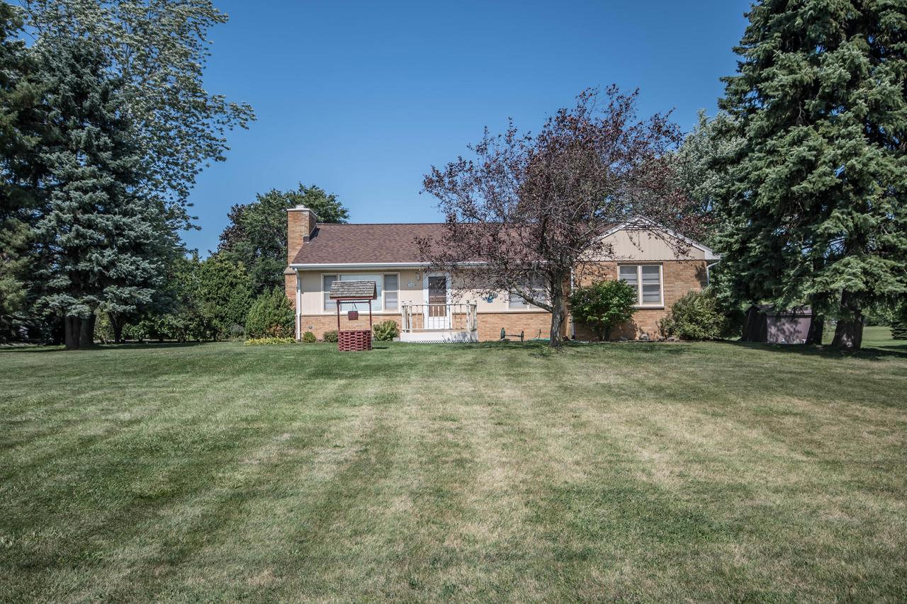 Special Lannon stone home located on a huge lot!. Natural fireplace, hardwood floors - so much potential at a price that can't be beat!