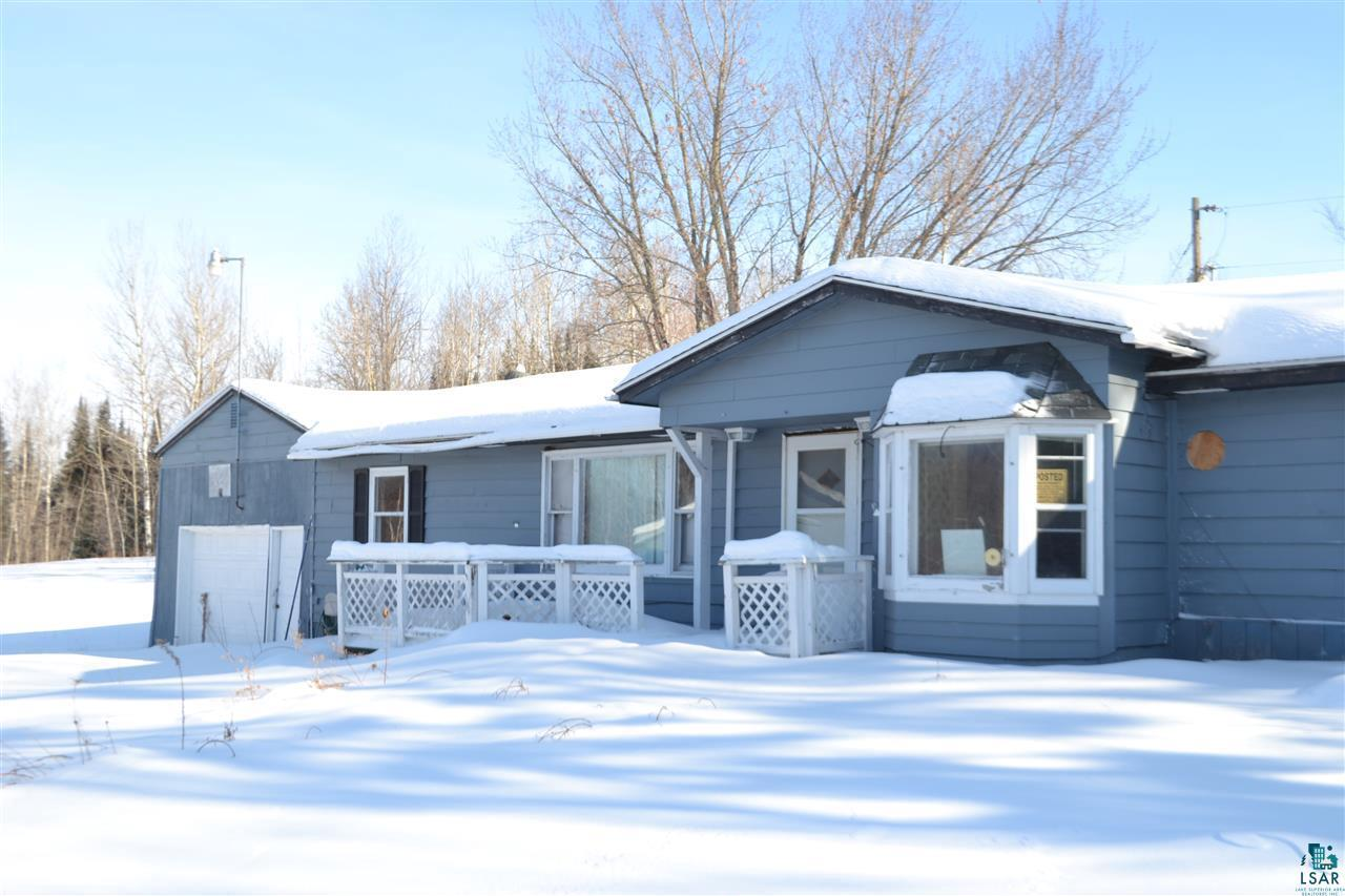 Plan B on County Rd B! This house could be everything you have hoped for. A 963 sqft 3 bed/1 bath dwelling sits on 5+ acres of fantastic land with utilities ready to go. Inside the house, the living room has classic wood paneled walls, decorative fireplace, and the most refined discount carpet available. It even has a ceiling fan and closet with shelves. The kitchen has matching black and white appliances and a decorative apple wallpaper back splash. There is also a sink, counter top, and some cabinets. A newer bay window was installed and is adorned with a white wood lattice, perfect for outside in your garden?or on your bright green walls! Each bedroom has its own distinct look. The first bedroom has a great window, baseboard heat, closet, primary color ceiling fan, and blue carpet. Bedroom two has a couple of windows, electrical panel, and a great green carpet. The third bedroom is the best, with plush purple carpet that covers almost all the floor, baseboard heat, ceiling fan, and wood paneling. The full bathroom has a more rustic feel but does include indoor plumbing, vanity sink, and medicine cabinet. Utilities in the home include a water heater, washer and electric dryer hook-ups, electric baseboard heat, drilled well, and septic. On the exterior of the house, is a 22x22 sqft garage, driveway, asphalt shingles, a large storage building, and lots of land. This DIY home may not have been what you first thought of, but it is absolutely ready to be everything you dreamed of with the added bonus of some of the materials already being at the site. With its great location and amount of land, it makes this Plan B home the place to be on County Rd B.  Year built is an estimate.  There is no information available from the county.  Foundation material is an guess also.  Listing agent has no access to the basement due to snow.  This home needs a ton of work.  Value is in the land, well, driveway, and electricity.  Garage is OK, with a dirt floor.  Home comes with all deb