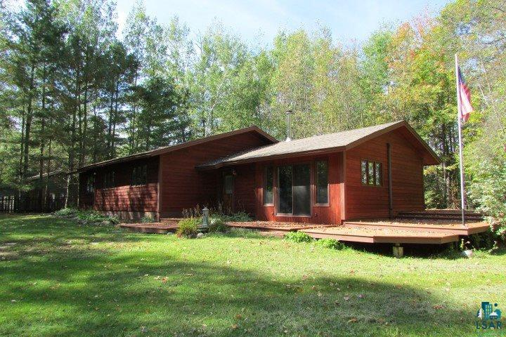 Living the lake life on Lyman Lake! One level living in this 1990 ranch style home situated on a beautiful 1.89 acres lot with 196 feet of frontage. Open floor plan and vaulted Red Cedar wood ceilings in the living/dining/kitchen. Many windows and patio doors through the home offer gorgeous natural light and views of the natural surroundings. Huge deck on 3 sides of the home, storage shed, fishing shack shed, barn with loft, finished 3 stall garage with one 16' door, heated with LP furnace. Colorado Silverstone pathways around the home and leading to the waterfront. The family room was added in 1995 and features a gas stove and access to the side yard. Master bedroom has a master bath and a patio door to the lake side deck.