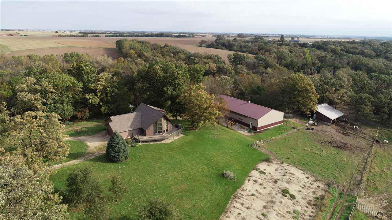 Here's a great little farm to bring your animals to and your hunting gear as well! Approx. 24 acres (to be surveyed) with pasture w/stream & woods. This is a well-built home with a fantastic view out of the great room, and a huge deck that wraps around a good part of the house, and a nice yard with apple & pear trees. And you get a 50' x 96' machine shed and 32' x 40' horse barn! Township is zoned. May require zoning change to split.  OR you can purchase the entire 54 acre property for the reduced price of $624,995.  Sellers to retain occupancy of property until April 1, 2020.   24 hour notice preferred for showings.  Additional tax parcels.