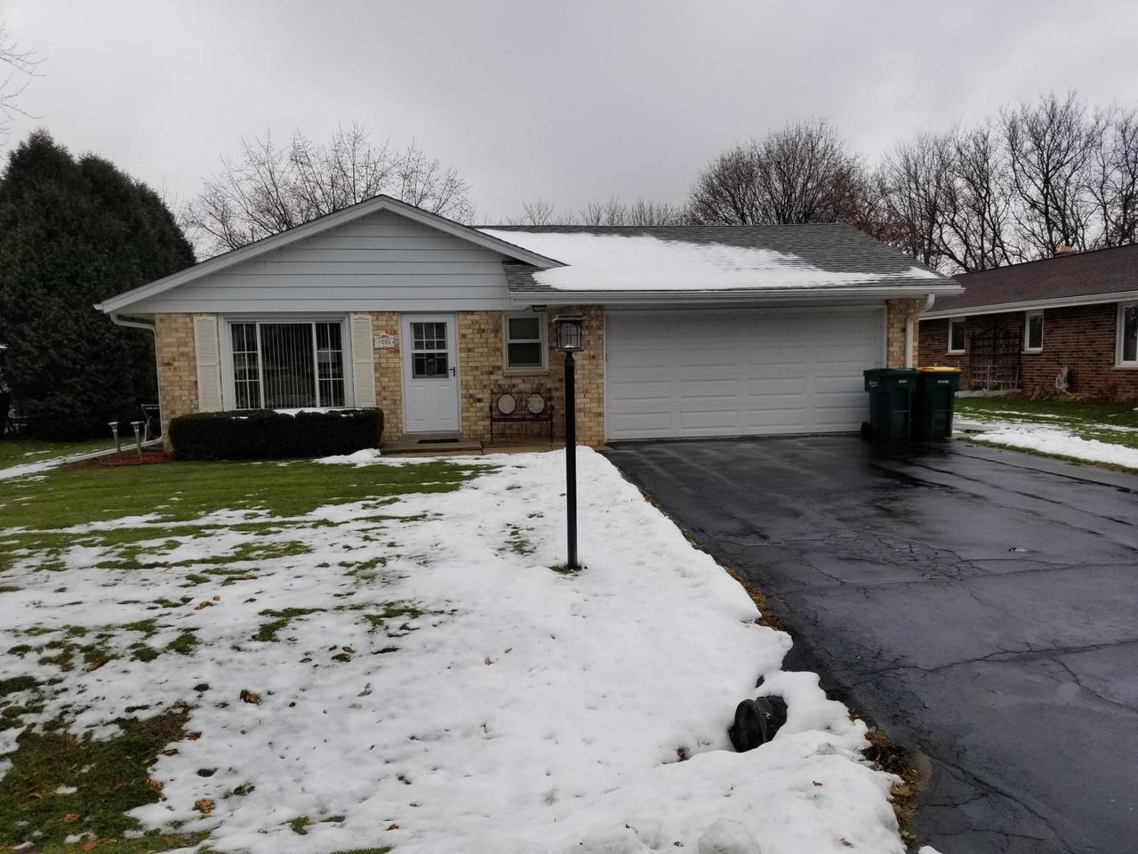 Nicely maintained brick ranch with large backyard and mature trees. Large concrete patio off the dining room. Lots of windows make this a bright and cheery home. The laundry room is in basement but there are hook-ups on the main level. Nice starter home and it's in the Slinger school district.