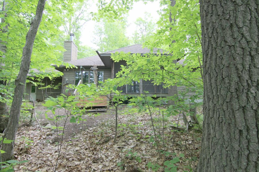 Incredible opportunity to own the only house on 30 acre Osprey Lake! The rest of the shoreline is owned by Washburn County. Over 22 wooded acres and approximately 2,000 feet of meandering shoreline. Two bedroom, two bath home featuring main floor laundry room, wood burning fireplace, three season porch, partially finished walkout lower level, sweeping views of pure Wisconsin Northwoods and incredible privacy. A third bedroom could be made in the lower level if desired.