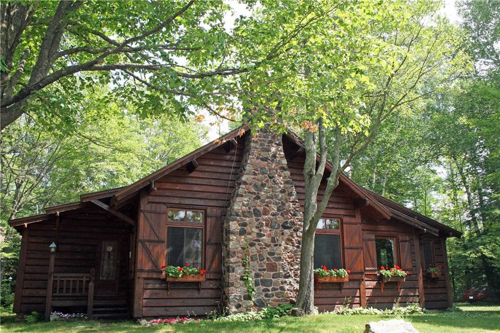 Two remarkable 1930?s Norwegian Craftsman built lodges, excellently maintained, 1800 ft. Upper St. Croix Lake w/ boathouse, docks, garage. BR, BA, SQ Ft. are combined details. St. Croix & Brule River accessible, 40 min to Duluth/Superior. Main Lodge: California-hewn cedar log; cedar interior, beamed ceiling, built-ins, DR/kitchen, 2 bedrooms + loft, 1 BA. Basement: washer/dryer, cedar cabinetry. Chalet Lodge: Stone & cedar exterior. 1st floor 2 stall garage & woodshop. 2nd floor cedar interior, open floor plan, beamed ceiling, skylights, screened balcony, DR/kitchen. 2 BR, walk-in closets. Full bath. Both have massive stone fireplaces. Fully furnished. Beautiful Cabinetry. Sleep 14+. Impeccable vintage.